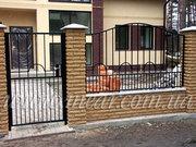 Металлические заборы,  ворота,  двери,  калитки.